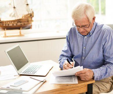 Senior Man Filing Tax Report