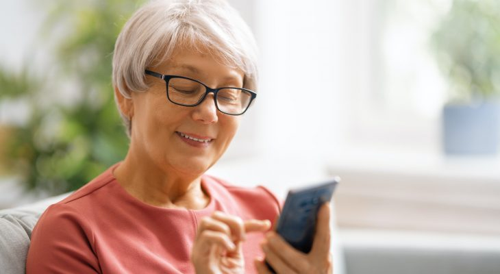 senior woman is using smartphone