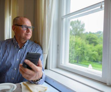 Portrait of senior man at home indoors