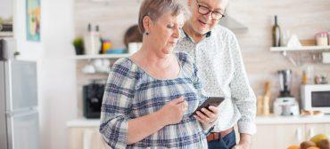 Senior couple using modern technology