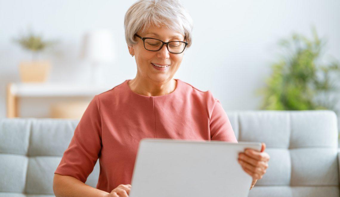 senior woman is using laptop