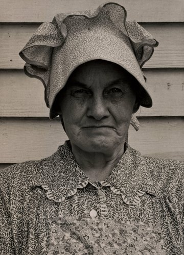 "Member of the congregation of Wheeley's church who is called ""Queen."" She is wearing the old fashioned type of sunbonnet. Her dress and apron were made at home. Near Gordonton, North Carolina, July 1939"