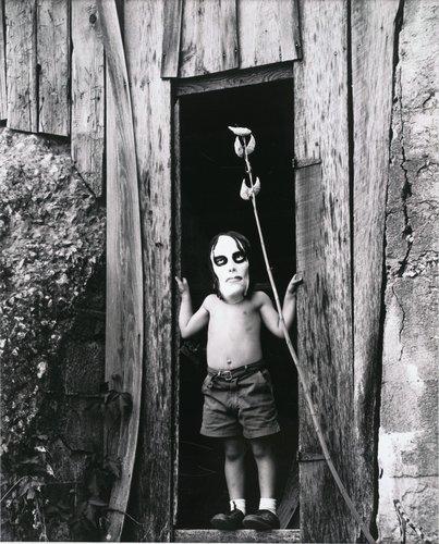 Untitled [Masked boy standing in doorway]