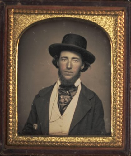 Untitled [Portrait of a Man with Hat and Cravat]