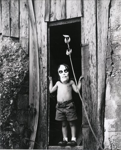 Untitled [Masked boy standing in doorway]
