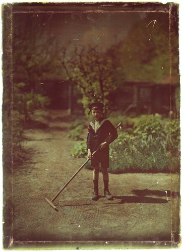Untitled [Boy with rake]