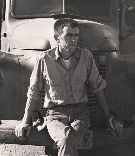 Untitled [Man sitting on truck bumper], from the series Walnut Grove: Portrait of a Town