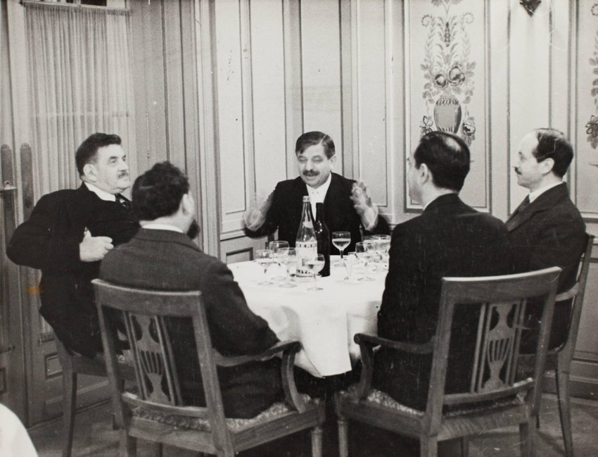image of 'Pierre Laval sitting at table with others'