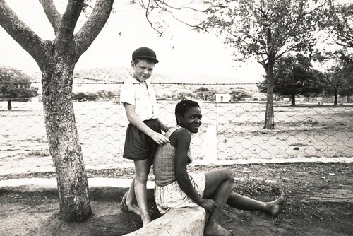Farmer's son with his nursemaid, Marico Bushveld. December 1964