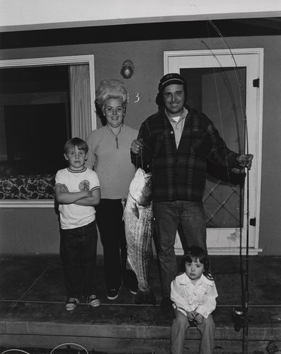 Man with fish and family, from the portfolio Leisure