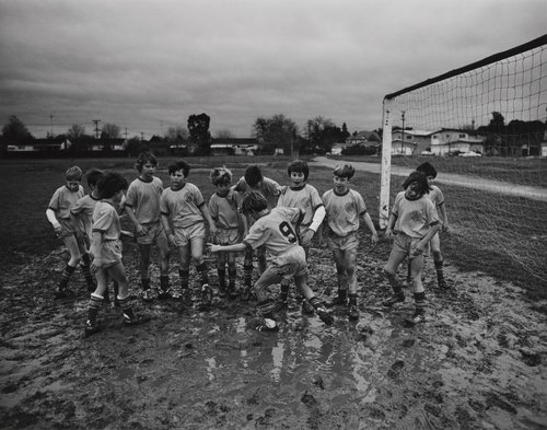 Muddy soccer game, from the portfolio Leisure
