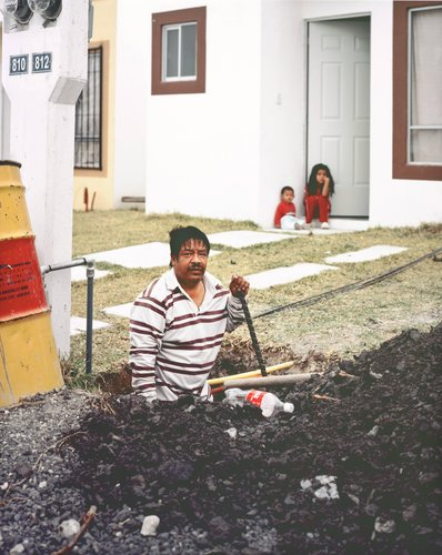 Man Digging Hole to Build a Fence for His New House in Juarez Suburb, from the series Suburbia Mexicana