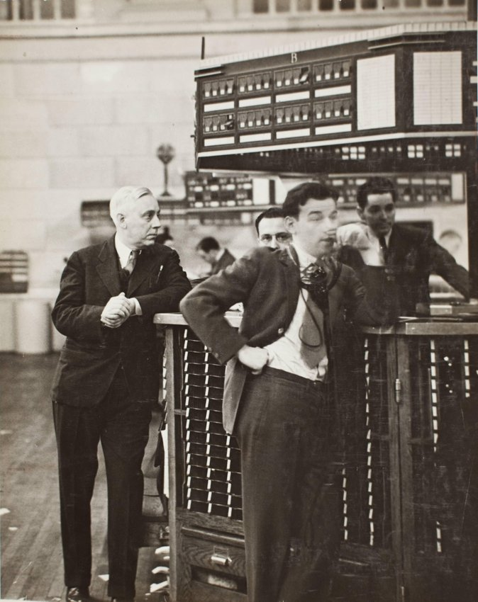 image of 'Governor of Stock Exchange James A. Corcoran with broker's clerk, quote boy and tube boy at exchange'
