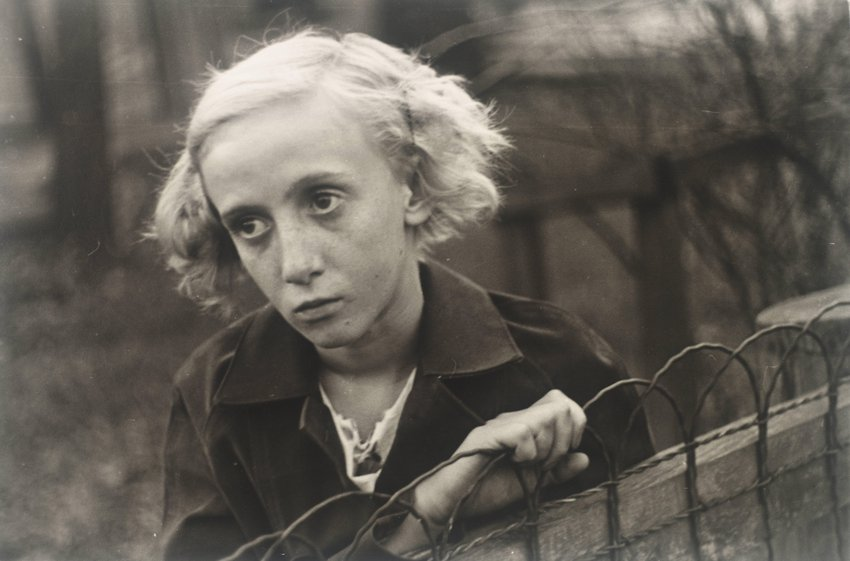 image of 'Untitled [Girl leaning on wire fence in yard, vicinity Bethlehem, Pennsylvania]'