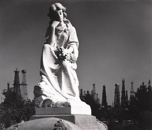 Cemetery Statue and Oil Derricks, Long Beach, California