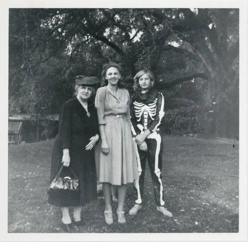 Untitled [Young woman wearing a skeleton suit, standing with two other women (probably her mother and grandmother)]