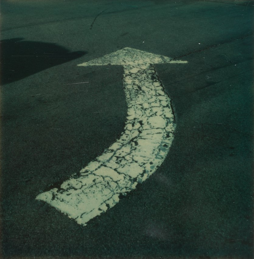 image of 'Untitled [Left turn arrow painted on road]'