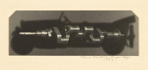 Crankshaft Silhouetted against Car