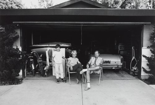 """Our house is built with the living room in the back, so in the evenings we sit out front of the garage and watch the traffic go by."" From the series Suburbia"
