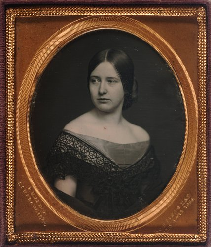 Untitled [Young woman in off-the-shoulder gown]