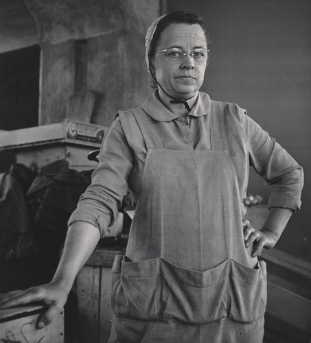 Untitled [Mennonite woman wearing apron, Farmer's Market, San Francisco]