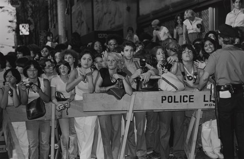 Fans behind police barrier, from the portfolio Leisure