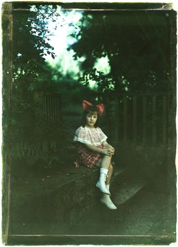 Untitled [Girl with red bow]