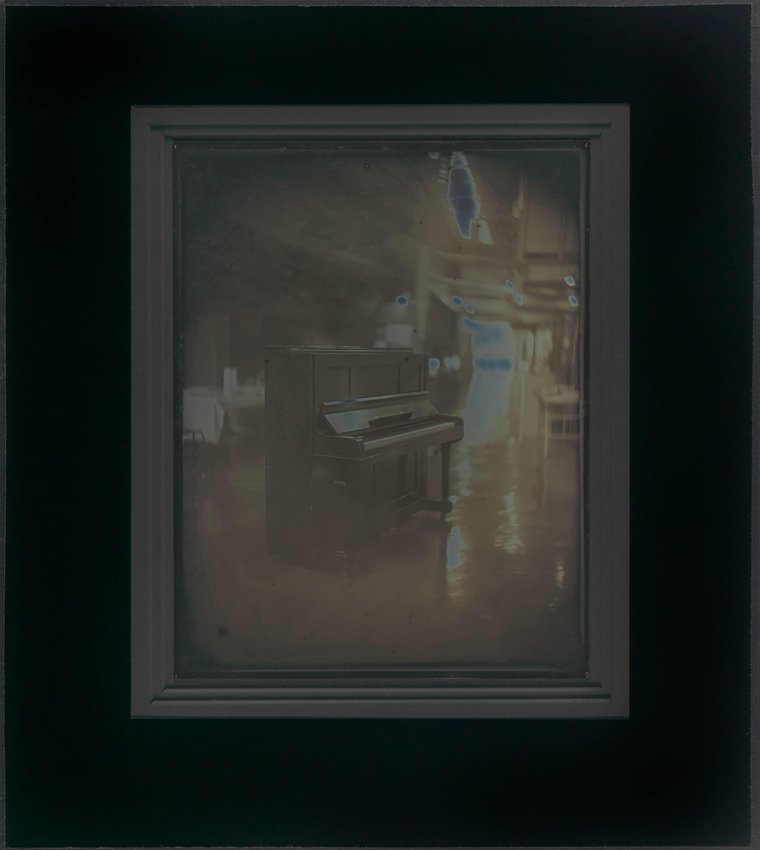 image of May 13, 2012. Misako's Hibaku Piano (the Piano Bombed and Exposed to the Radiation in the Atomic Bombing on Hiroshima in 1945), Daigo Fukuryu Maru Exhibition Hall, Tokyo, from the series EXPOSED IN A HUNDRED SUNS