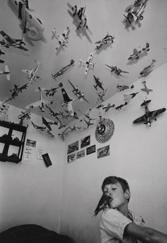 Boy in his bedroom with bird, from the portfolio Leisure