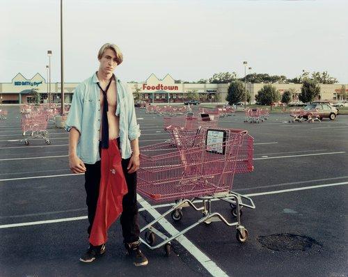 A Young Man Gathering Shopping Carts, Huntington, New York, July 1993