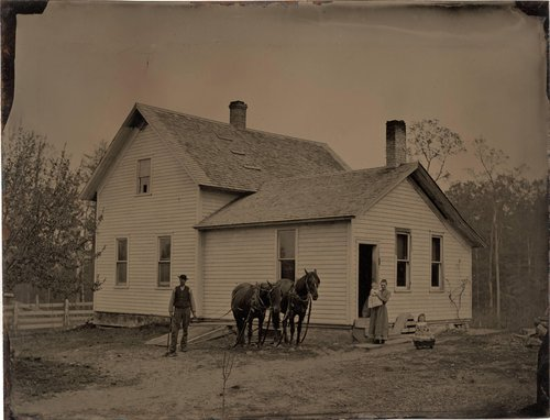 Untitled [Family in front of farmhouse]