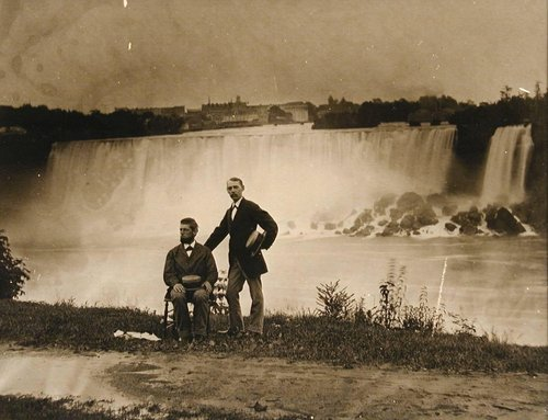 Untitled [Two men posing in front of Niagara Falls]