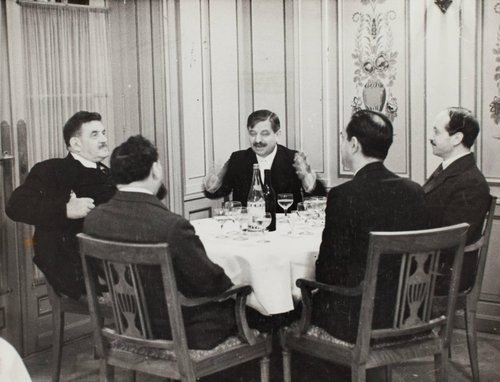 Pierre Laval sitting at table with others