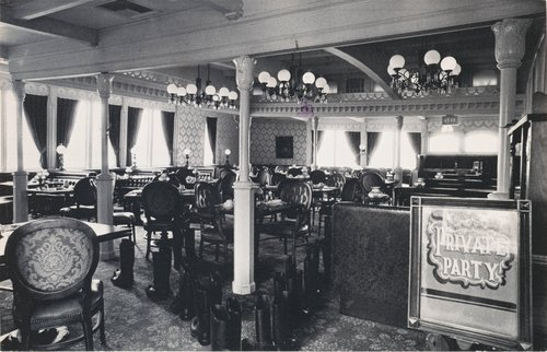 100 Boots in the Saloon, from the series 100 Boots, a set of 51 photo-postcards