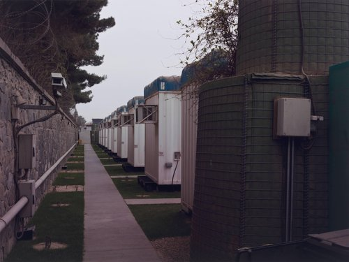 Accommodation units, known as 'pods', for lower ranking diplomats of the British Embassy, from the portfolio Burke + Norfolk: Photographs from the War in Afghanistan by John Burke and Simon Norfolk