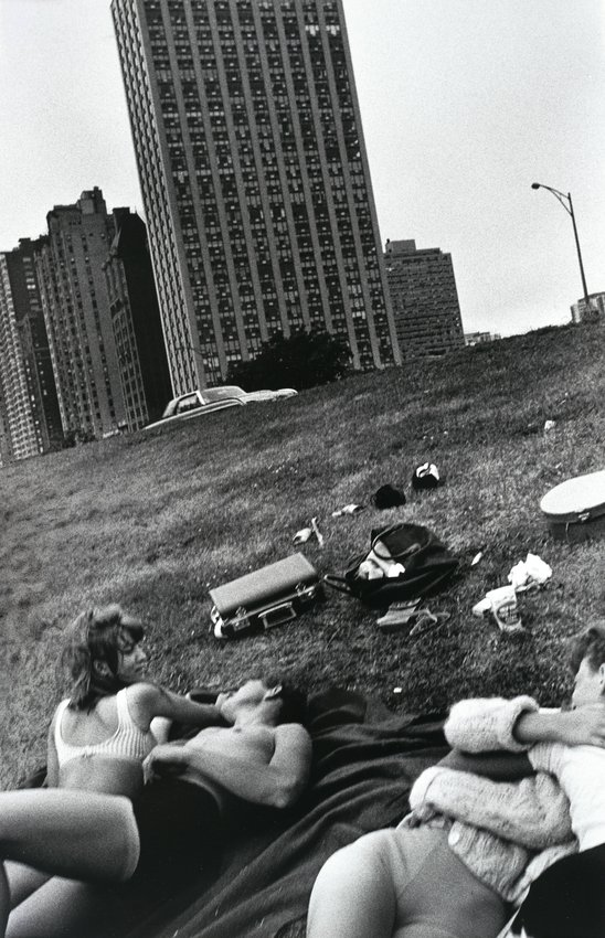image of 'Kids Lying near High Rises, from the series The Age of Adolescence'