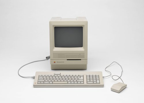 Macintosh SE/30 desktop computer with keyboard and mouse