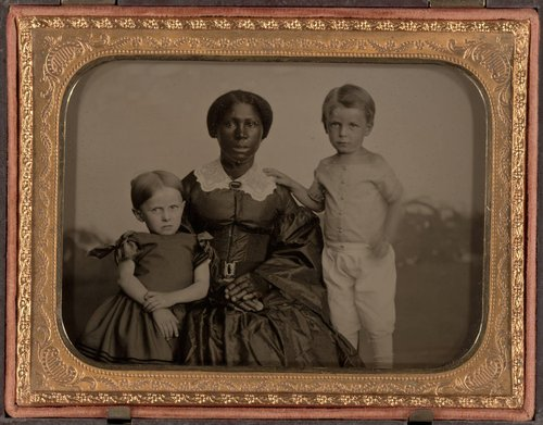 Untitled [African-American woman with two white children]