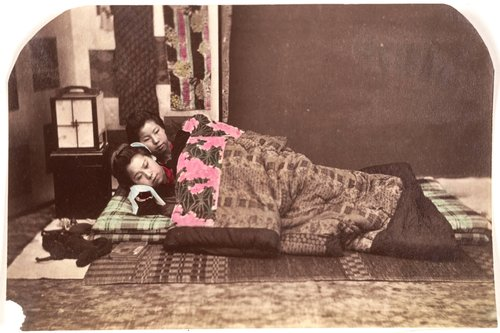 Untitled [Two Asian women lying on a futon]