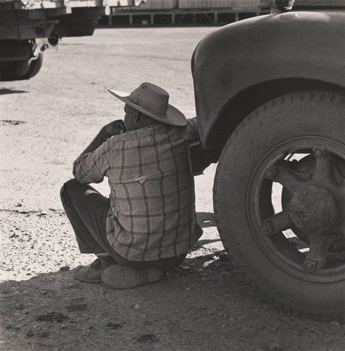 Untitled [Man resting in shade of truck], from the series Walnut Grove: Portrait of a Town