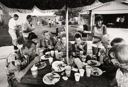 """This is our second annual Fourth of July block party. This year thirty-three families came for beer, barbequed chicken, corn on the cob, potato salad, green salad, macaroni salad and watermelon. After eating and drinking [...]"" From the series Suburbia"