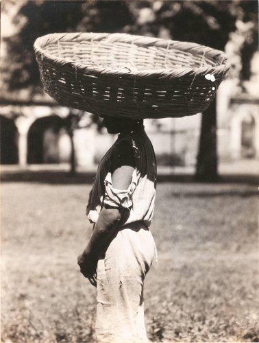 "Untitled [""A bakery boy in a little town carrying bread in that basket to sell""]"