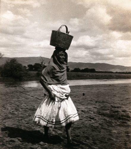 Untitled (Woman Lifting Skirt with Basket on Head)