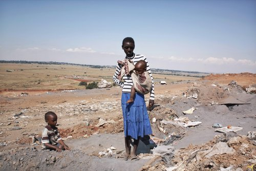 Untitled [Woman with children, Zimbabwe], from the series On the Way to Pretoria