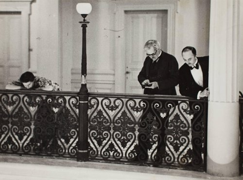 British statesman Ramsay MacDonald with his daughter Isabel and his secretary Mr. Butler, looking down from hotel balcony as he watches French Premier Édouard Herriot in the lobby during the Lausanne Reparation Conference, Switzerland.