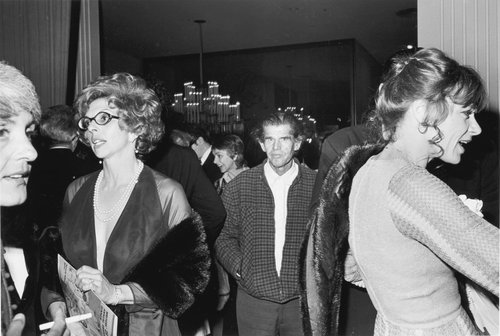 Man walking through a private party, Beverly Hilton Hotel