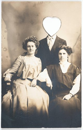 Untitled [Portrait of three people, with one man's face cut out of the print in a heart shape]