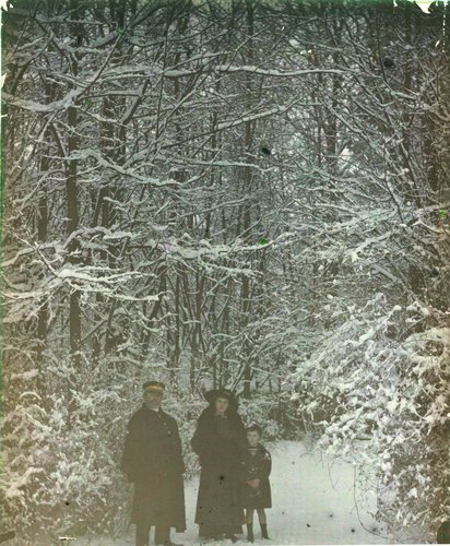 Untitled [Family in a snowy forest]