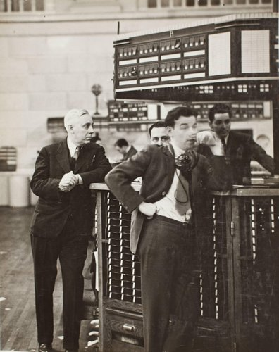 Governor of Stock Exchange James A. Corcoran with broker's clerk, quote boy and tube boy at exchange