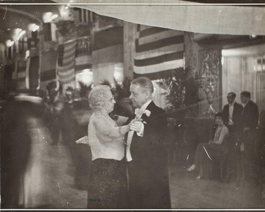image of 'Italian Embassy party: Mrs. Jacob Leander Loose dances with General Horton'